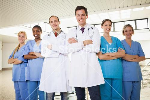 Doctors with nurses with arms crossed