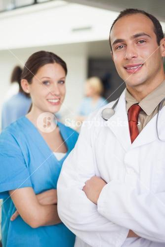 Doctor and nurse with arms crossed