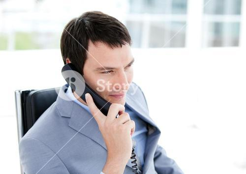 Charming young businessman talking on phone