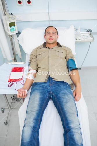 Male patient lying on a bed