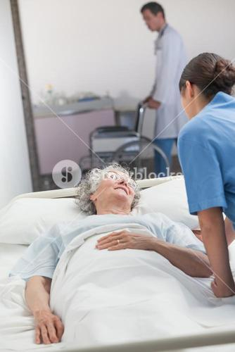 Nurse looking after an elderly patient