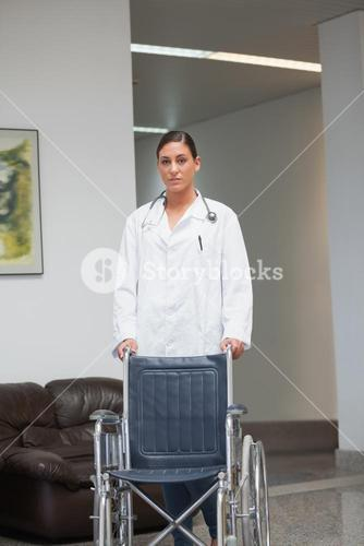 Doctor holding a wheelchair