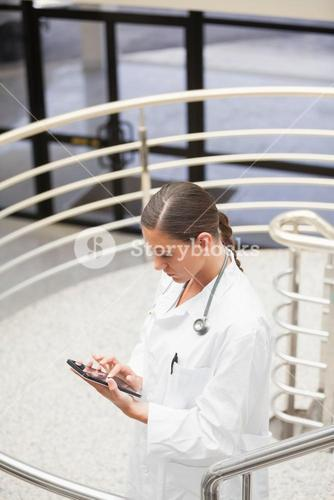 High angle view of a doctor using a tablet computer