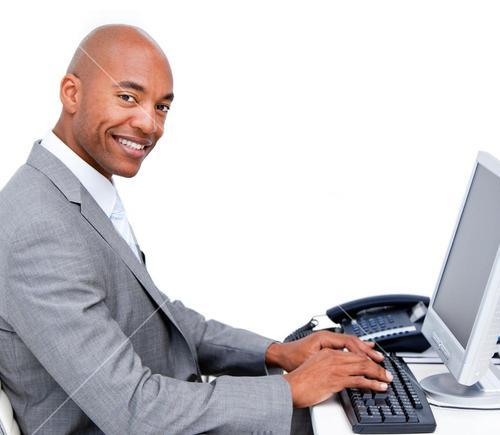 Charming businessman working at a computer