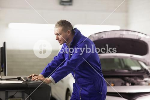 Mechanic looking at a computer