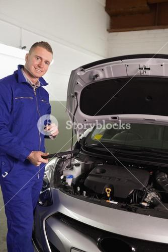 Mechanic holding a tablet computer