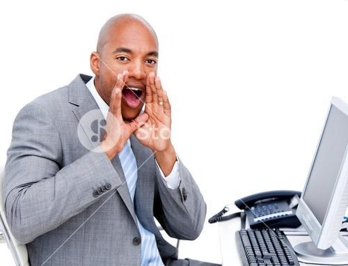 Businessman yelling sitting at his desk