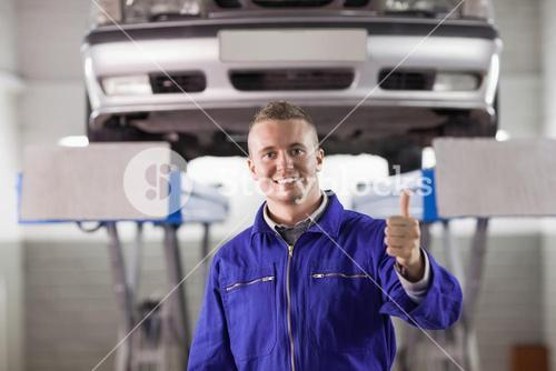 Mechanic standing with thumb up