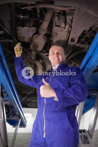 Man repairing a car with an adjustable pliers