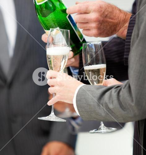 Close up of a business person serving Champagne
