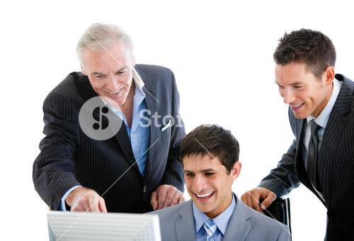 Selfassured businessmen working at a computer