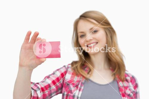 Smiling woman holding a loyalty card