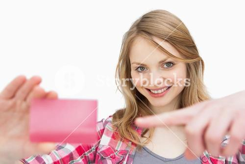 Woman holding a loyalty card while showing it
