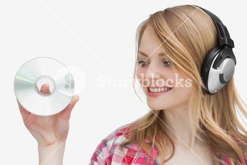 Woman holding a cd while looking it