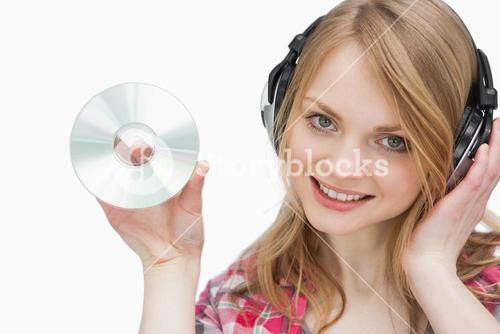 Woman holding a cd while looking at camera