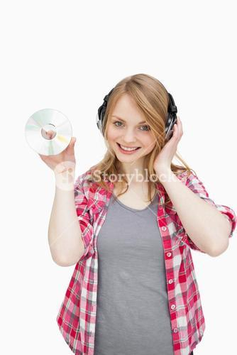 Woman standing while holding a cd