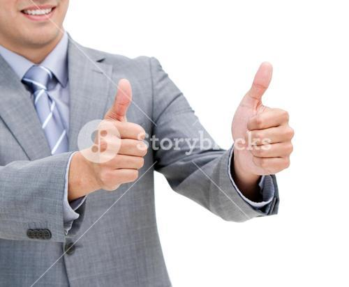 Close up of a young businessman with thumbs up
