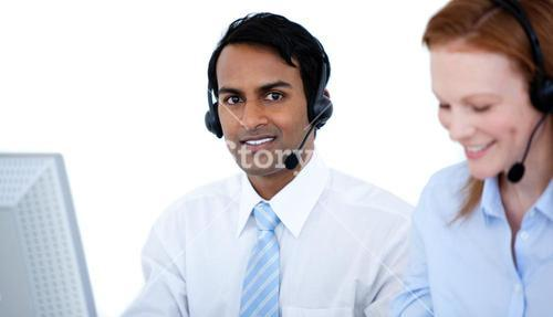 Confident business group in a line working at computers