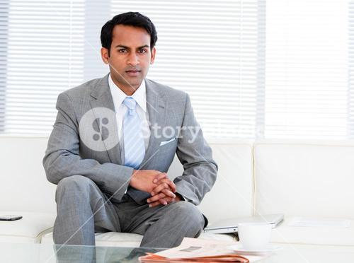 Selfassured businessman sitting on the sofa