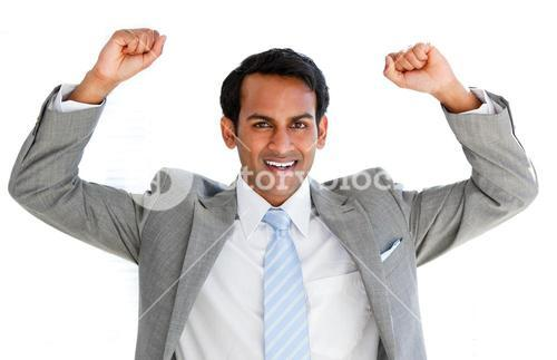 Jolly businessman punching the air in celebration