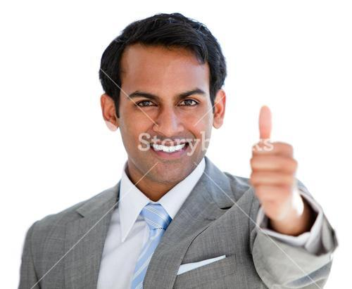 Portrait of a cheerful businessman with a thumb up