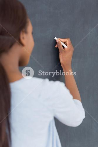 Focus on a black woman holding a chalk