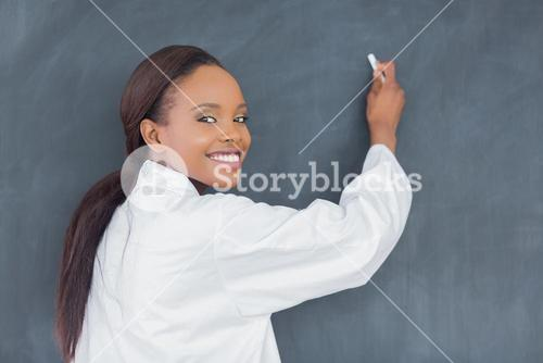 Black teacher holding a chalk