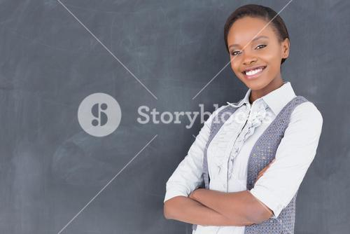 Teacher smiling with arms crossed