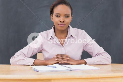 Front view of a black teacher looking at camera