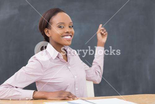 Black teacher showing the blackboard