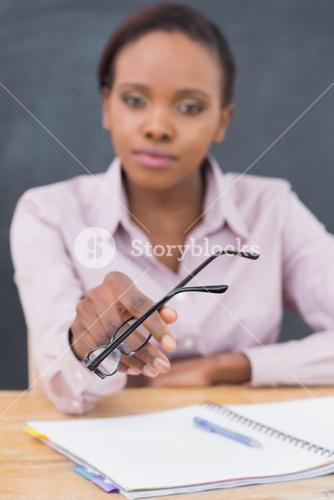 Focus on glasses of a teacher