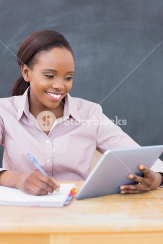Teacher looking at a tablet computer