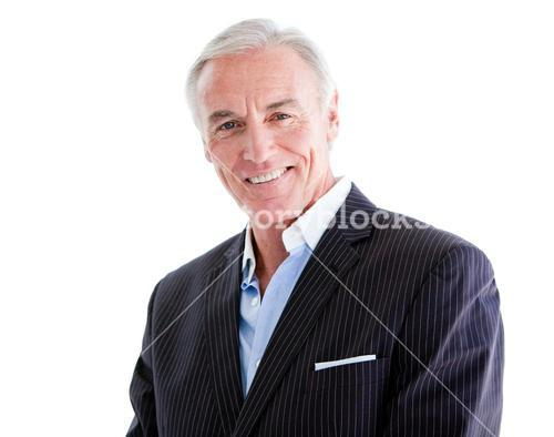Assertive senior businessman standing