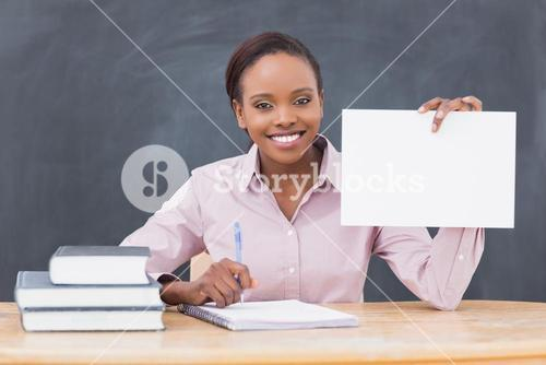 Black teacher holding a blank paper