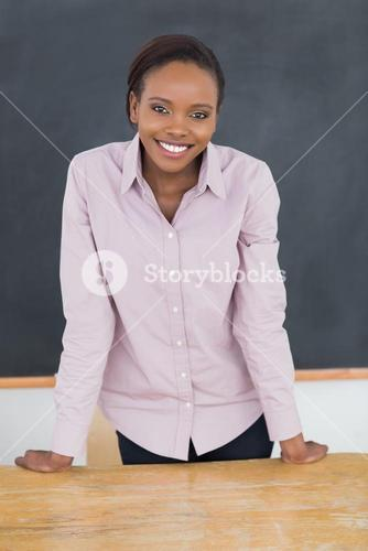 Teacher standing up while smiling