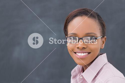 Close up of a black woman wearing glasses