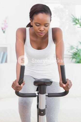 Woman doing exercise bike