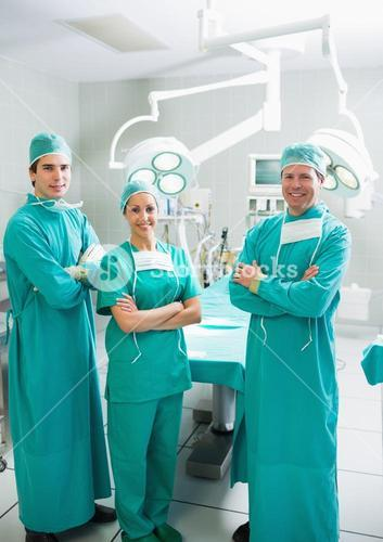 Surgeons smiling with arms crossed
