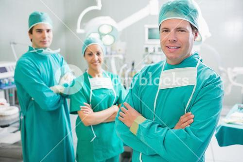 Surgical team smiling with arms crossed