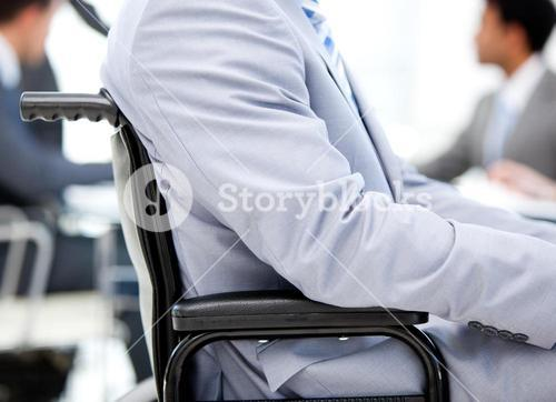 Close up of a businessman sitting on a wheelchair