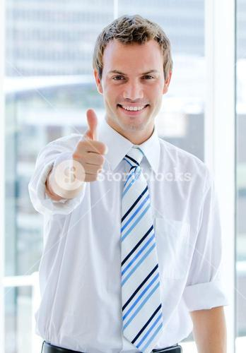 Portrait of a charismatic businessman with a thumb up