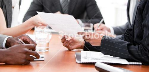 Close up of business people in a meeting