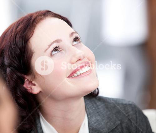 Radiant young buinesswoman smiling in a meeting