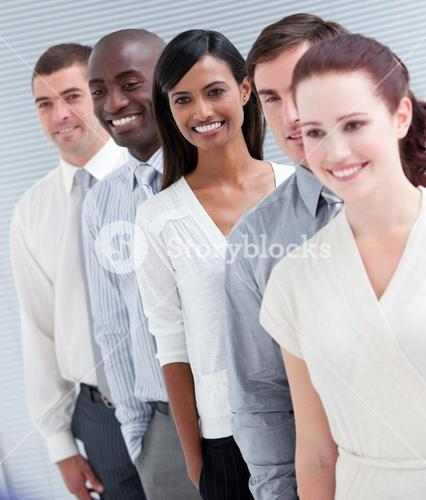 Cheerful business partners standing in a line