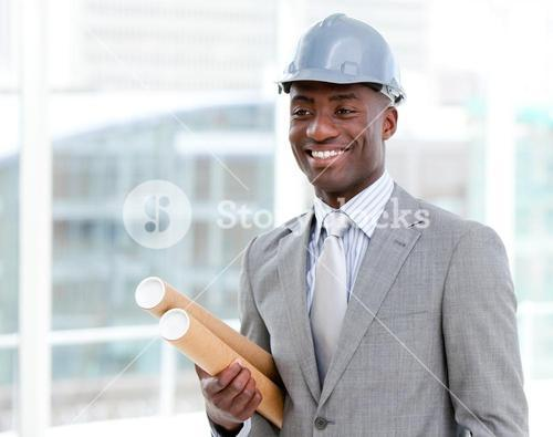 Portrait of a cheerful male architect holding blueprints