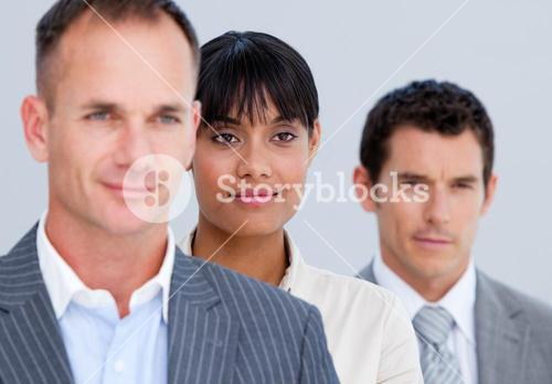 Selfassured business partners standing in a line