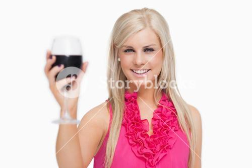 Blonde holding a glass of wine