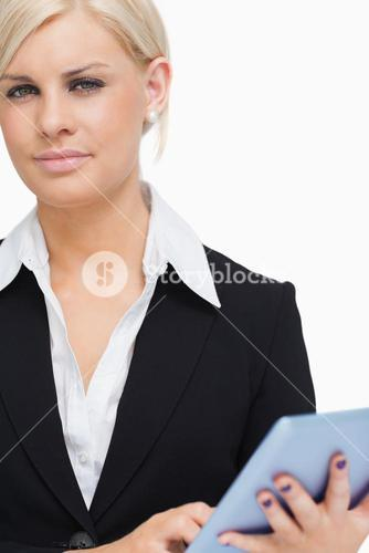 Green eyed businesswoman holding a tablet