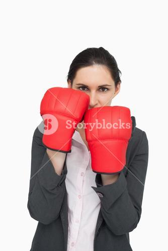 Combative brunette wearing red gloves
