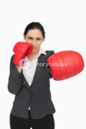 Brunette wearing red gloves punching